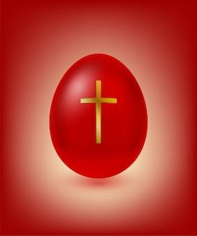 Œuf de pâques rouge avec croix dorée