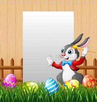 Oeuf de peinture joyeux pâques lapin avec fond de signe vierge