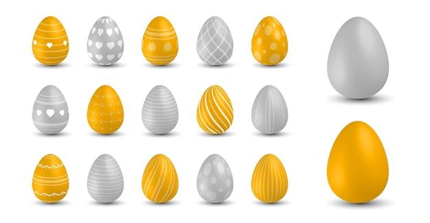 Oeufs de pâques colorés. oeuf de pâques, symbole traditionnel de vacances de printemps. décoration saisonnière réaliste d'ornement coloré. illustration couleur or et gris collection pantone 2021