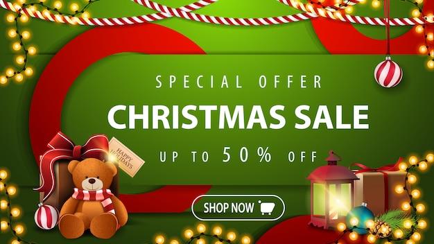 Offre spéciale, vente de noël, jusqu'à 50% de réduction, bannière verte horizontale moderne et lumineuse, vert