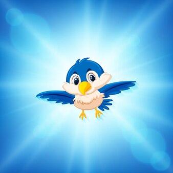 Oiseau bleu volant sur fond de ciel bleu