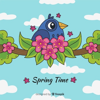 Oiseau sur fond de printemps branche