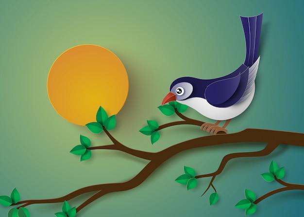 Oiseau perché sur une branche d'un arbre.