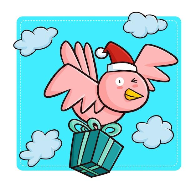 Oiseau rose kawaii mignon et drôle portant le chapeau du père noël, apportant un cadeau de noël