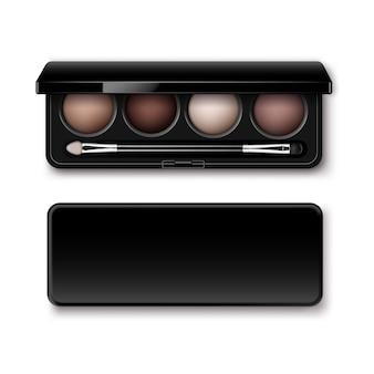 Ombres à paupières ocre crème marron clair multicolore rond dans un boîtier en plastique rectangulaire noir avec applicateur de pinceau de maquillage vue de dessus isolée
