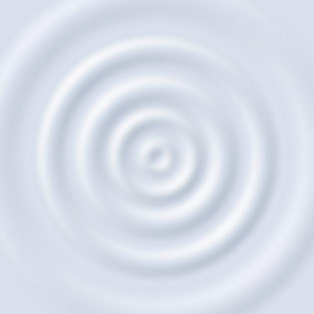 Ondulation du lait. cercle de crème au yaourt. bouchent la vue de dessus la texture des ondulations circulaires du lait blanc