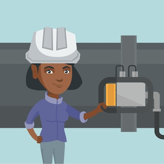 Opérateur vérifiant le détecteur sur le pipeline.