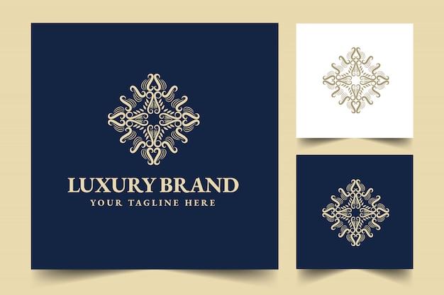 Or calligraphique féminin floral dessiné à la main monogramme héraldique logo de luxe de style vintage antique