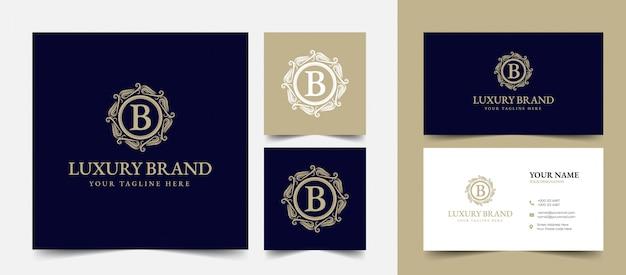 Or calligraphique féminin floral dessiné à la main monogramme héraldique logo de luxe vintage antique