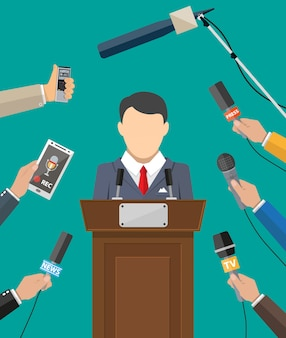 Orateur public et mains des journalistes