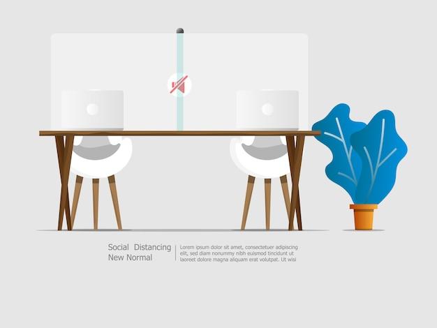 Ordinateur portable sur le bureau avec la séparation sociale de la partition