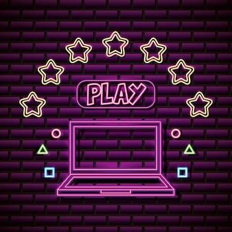 Ordinateur portable et étoiles dans le style néon, jeux vidéo liés