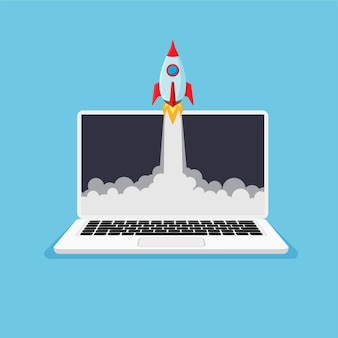 Ordinateur portable avec lancement de fusée à l'écran produit d'entreprise la fusée va au-delà du moniteur démarrage du projet