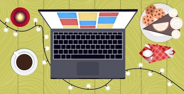 Ordinateur portable lumières de noël café et dessert sur la table hiver vacances célébration concept haut angle vue illustration
