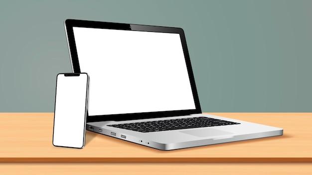 Ordinateur portable et téléphone intelligent avec écran vide sur table