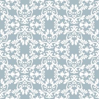 Ornement blanc sur fond bleu clairdamas floral fond d'hiver sans couture