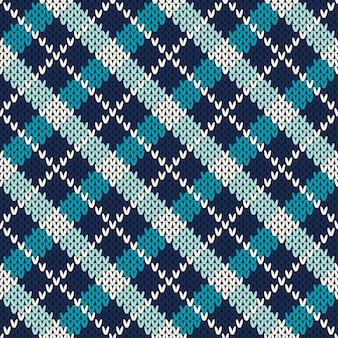 Ornement de modèle sans couture sur la texture tricotée en laine