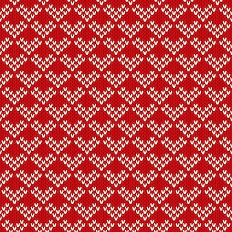 Ornement de modèle sans couture sur la texture tricotée en laine.