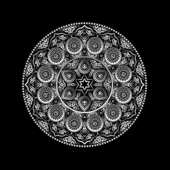 Ornement rond métallique sur fond noir - style arabe, islamique et oriental.
