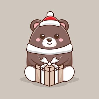 Ours brun de caractère tenant un cadeau pour noël