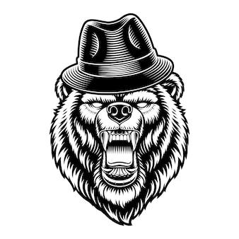 Ours dans un chapeau isolé sur blanc