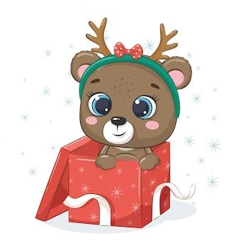 Ours mignon dans une boîte cadeau.