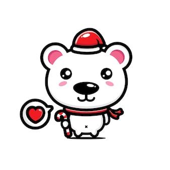 Ours mignon portant un chapeau de père noël