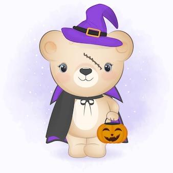 Ours mignon portant un costume d'halloween et tenant une illustration d'halloween à la citrouille