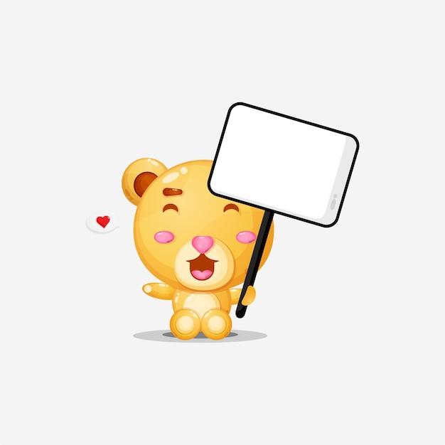 Ours mignon tenant une pancarte blanche avec coeur dans le discours de la bulle
