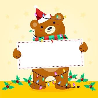 Ours de noël tenant une bannière vierge