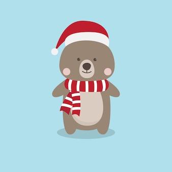Un ours en peluche marron mignon avec un chapeau de père noël