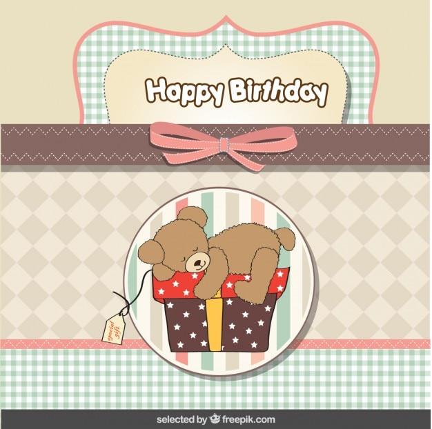 Ours en peluche sur la présente carte d'anniversaire dans des couleurs pastel