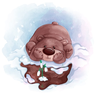 L'ours en peluche regarde les perce-neige qui ont fleuri au printemps. texture aquarelle