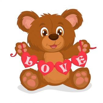 Ours en peluche tenant une guirlande de coeurs rouges