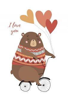 Ours sur un vélo avec des ballons en forme de coeur
