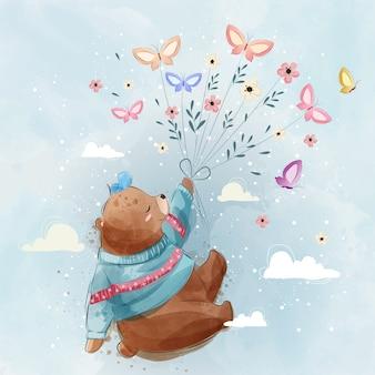 Ours volant avec des papillons