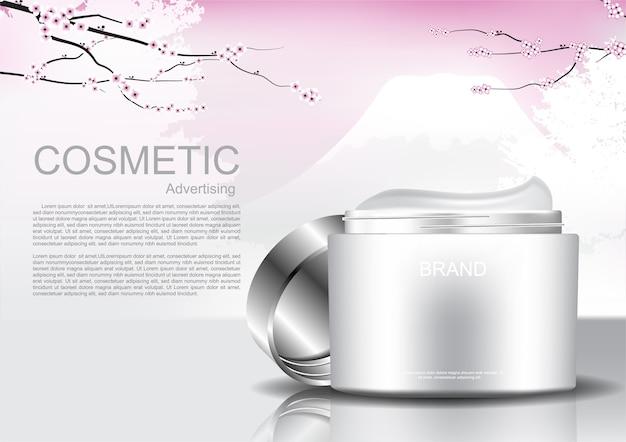 Ouvert crème cosmétique et branche de fleurs