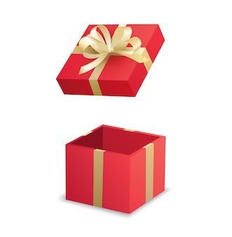 Ouvrez la boîte cadeau rouge et ruban d'or isolé sur fond blanc.