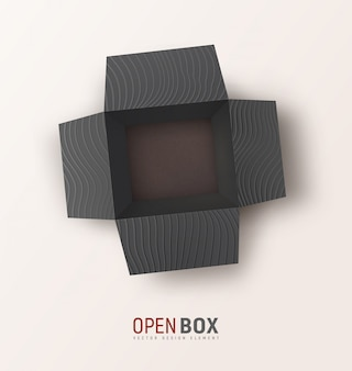 Ouvrez la boîte cadeau texturée noire sur fond clair. vue de dessus coffret isolé. maquette, élément de conception