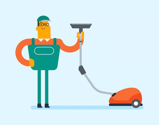 Ouvrier cucasien nettoyant le sol avec un aspirateur