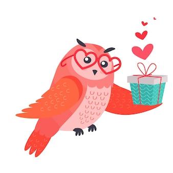 Owl bird dans des lunettes en forme de coeur contient une boîte à cadeaux