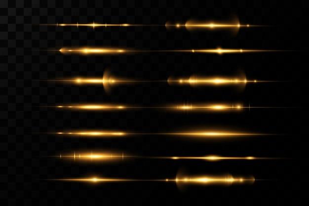 Pack de fusées éclairantes horizontales dorées. faisceaux laser, rayons lumineux horizontaux.