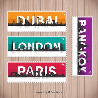 Pack de grands timbres de villes avec des silhouettes