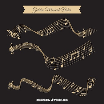 Pack d'or de notes musicales et pentagrammes