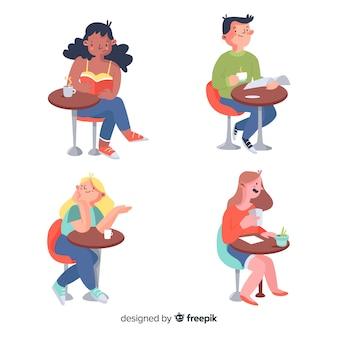 Pack de personnes assises dans un café