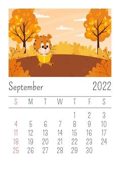 Page de calendrier pour 2022, septembre. un tigre mignon de bande dessinée est assis sous un arbre en lisant un livre.