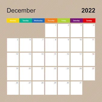 Page de calendrier pour décembre 2022, planificateur mural au design coloré. la semaine commence le lundi.