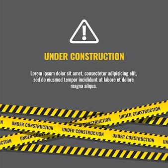 Page de site web en construction avec illustration de bordures rayées noires et jaunes