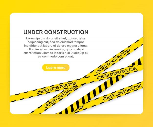 Page de site web en construction avec modèle de frontières rayées noir et jaune