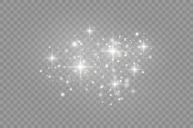Paillettes sur un transparent. étincelle les étoiles avec une lumière spéciale.